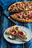 Rhubarb tart. Slice of rhubarb tart served on a grey plate stock photos