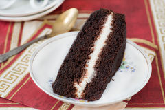 Slice of rich moist chocolate cake Royalty Free Stock Photos