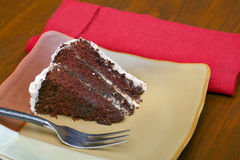Slice of rich moist chocolate cake Royalty Free Stock Image
