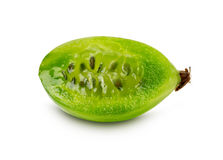 Slice of ripe juicy gooseberry on the white background Royalty Free Stock Images