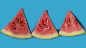 Triangular lobules of watermelon with seeds on a turquoise background. Slice of ripe and juicy watermelon , isolated on white. Top view. triangular lobules of stock photos