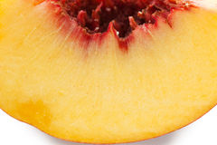 A slice of ripe peach, selective focus. Isolated on white Royalty Free Stock Photos