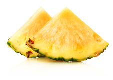 Slice of ripe pineapple on a white background Royalty Free Stock Photography
