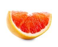 Slice of ripe red grapefruit Royalty Free Stock Image