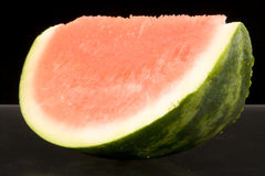 Slice of ripe water melon. With dark background Stock Photo