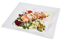 Slice roast salmon in white sauce with vegetables and rosemary. Stock Images