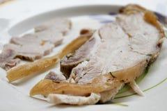Slice of roast suckling pig or porchetta Stock Photo
