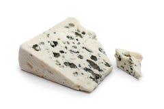 Slice of Roquefort cheese Stock Photos