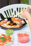 The slice of a row fish. Picnic in a park royalty free stock image