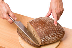 Slice of rye bread on a cutting board Stock Photo