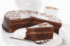 Slice of Sacher cake in plate with coffee Royalty Free Stock Photo