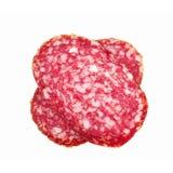 Slice of salami background sausage cut. Slices of salami. Isolated on a white background. sausage cut stock images
