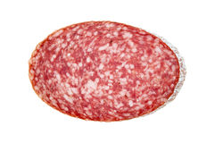 Slice of salami sausage. Sausage on a white background royalty free stock photography
