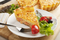 Slice of Salmon Quiche on a Plate with a Fork Stock Photos