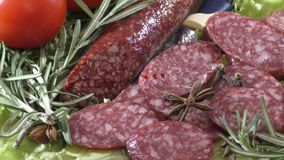 Slice sausage and fresh herbs stock video