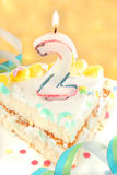 Slice second birthday cake Stock Photo