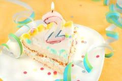 Slice second birthday cake Stock Photo