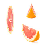 Slice section of grapefruit isolated over the white background Royalty Free Stock Photos