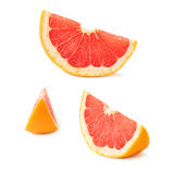 Slice section of grapefruit isolated over the white background Stock Images