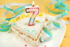Slice of seventh birthday cake Stock Image