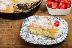 Slice of skillet cake with cream and berry Stock Photography