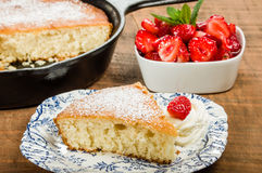 Slice of skillet cake with cream and berry Royalty Free Stock Images