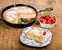 Slice of skillet cake with cream and berry Royalty Free Stock Photo