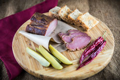 Slice of smoked ham Stock Images