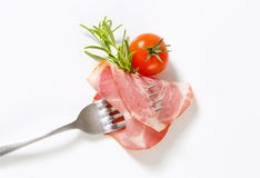 Slice of smoked pork neck on fork Royalty Free Stock Images