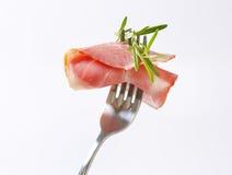 Slice of smoked pork neck on fork Stock Photos