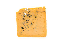 Slice of soft blue cheese with mold  Stock Images