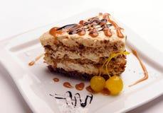 Slice of sour cream cake. Royalty Free Stock Photo