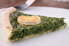 Slice of spinach quiche Royalty Free Stock Image