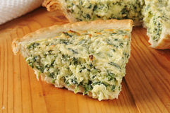 Slice of spinach quiche Royalty Free Stock Photography
