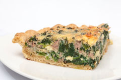 Slice of spinach and tuna quiche lorraine baked Royalty Free Stock Image