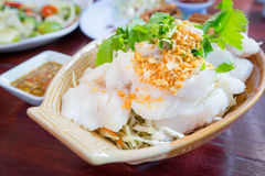 Slice steamed fish with fried garlic topping and spicy sauce. Stock Images