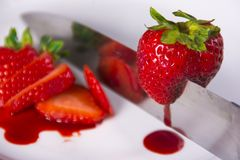 Slice of Strawberries. Sweet strawberries dripping with flavor royalty free stock photography