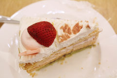 Slice of strawberry cake on a white plate Stock Photography
