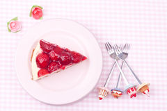 A slice of strawberry cheesecake Stock Photography