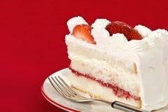 Slice of strawberry cream cake Stock Image