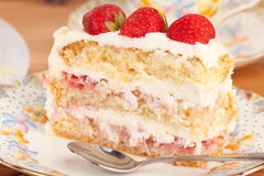 Slice of strawberry and mascarpone cake Stock Images