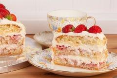 Slice of strawberry and mascarpone cake Stock Photos