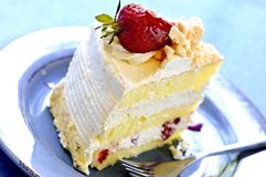 Slice of strawberry meringue cake Stock Image