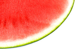 Slice of Summer Fun - Juicy Red Seedless Watermelon. Closeup of a slice of watermelon.  Side view shows skin, rind, and ruby red fruit.  No seeds.  White Royalty Free Stock Photography