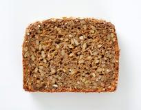 Slice of sunflower bread Stock Image