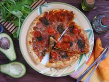 A Slice of supreme pizza on rustic wooden table. Supreme pizza on rustic wooden table royalty free stock photos