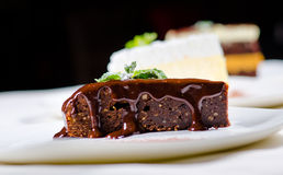Slice of Sweet Chocolate Cake with Chocolate Syrup Royalty Free Stock Photography