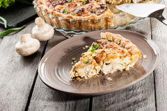 Slice of tart with chicken amd mushrooms Royalty Free Stock Images