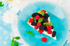 Slice of a tart with fresh berries. Stock Photos