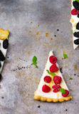 Slice of a tart with fresh berries. Royalty Free Stock Images